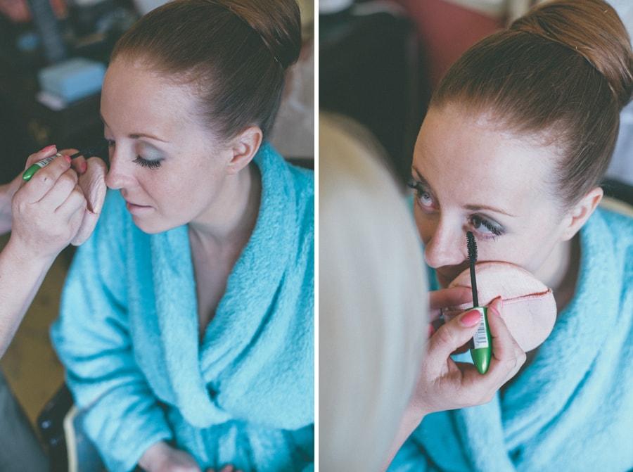 Katie having her makeup done on her wedding day
