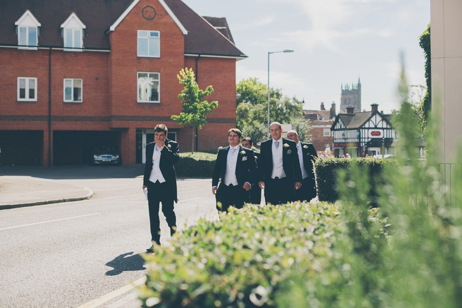 Groomsmen making their way to the church