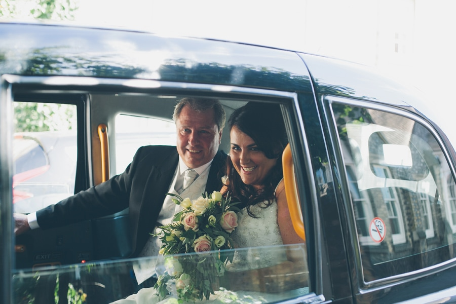 Bride and father arrive to the church in Hertford, Hertfordshire