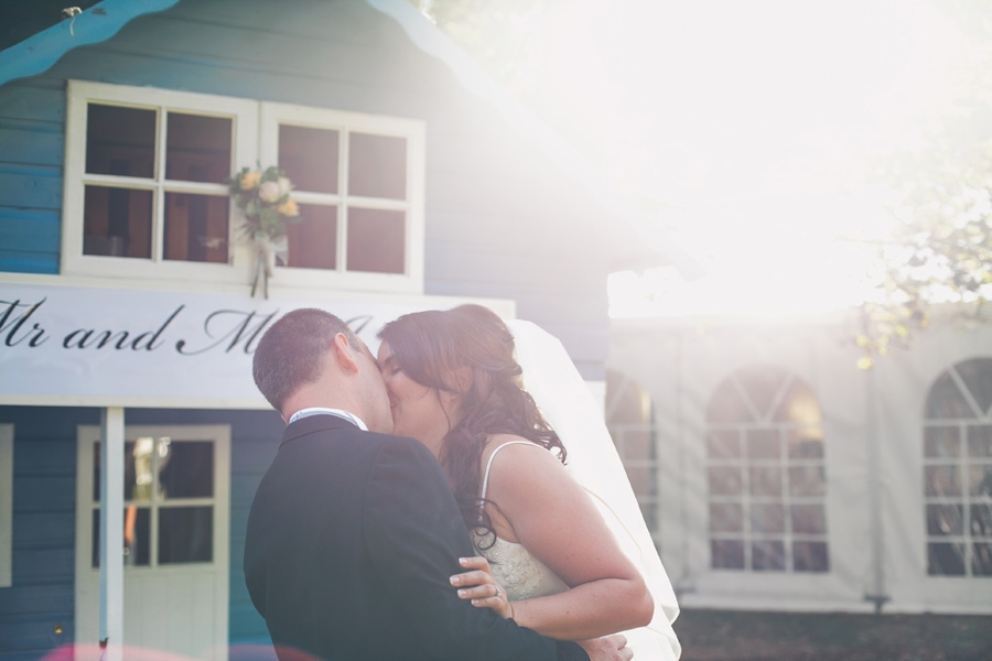 Jackie & Jez kiss outside the marquee