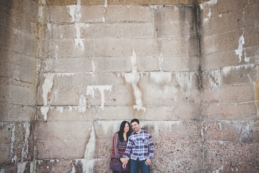 tonia and matt next to a great wall in southend, essex