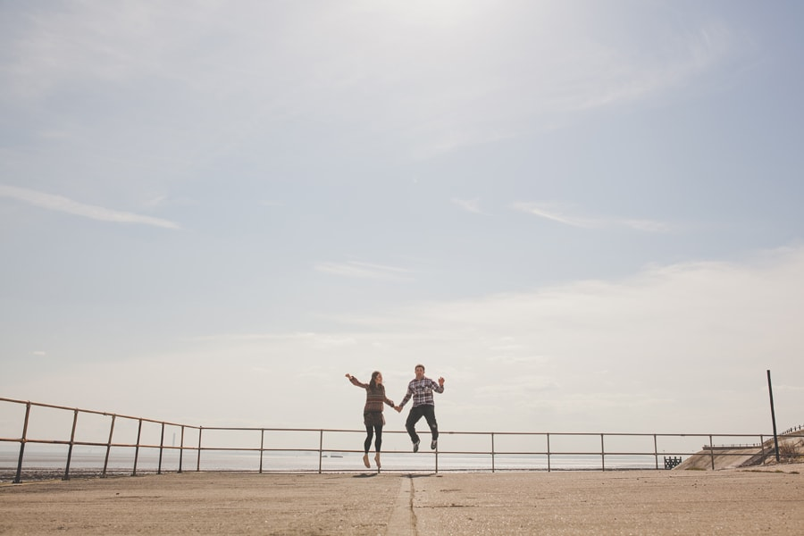 jumping shot of matt and tonia in southend, essex