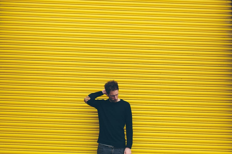 press shot for Attaque in front of yellow shutter