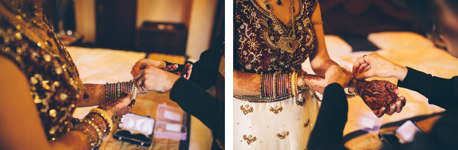 bride putting on her jewerly for her asian wedding at Copthorne Hotel