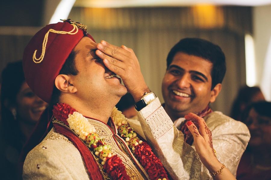 the groom having his eyes hidden at Copthorne Hotel wedding