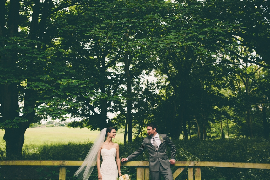 bride and groom in the woods in ireland