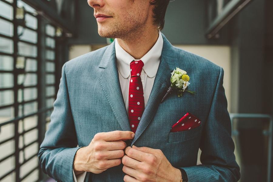 ross holding his blazer