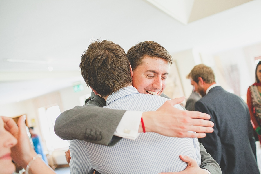 groom leaning in for a hug