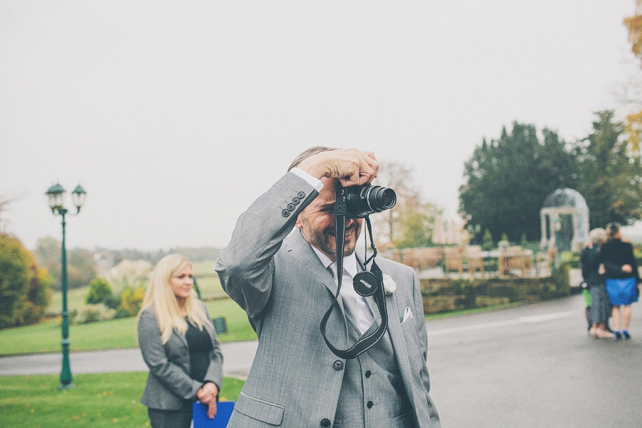 father of the groom taking photo