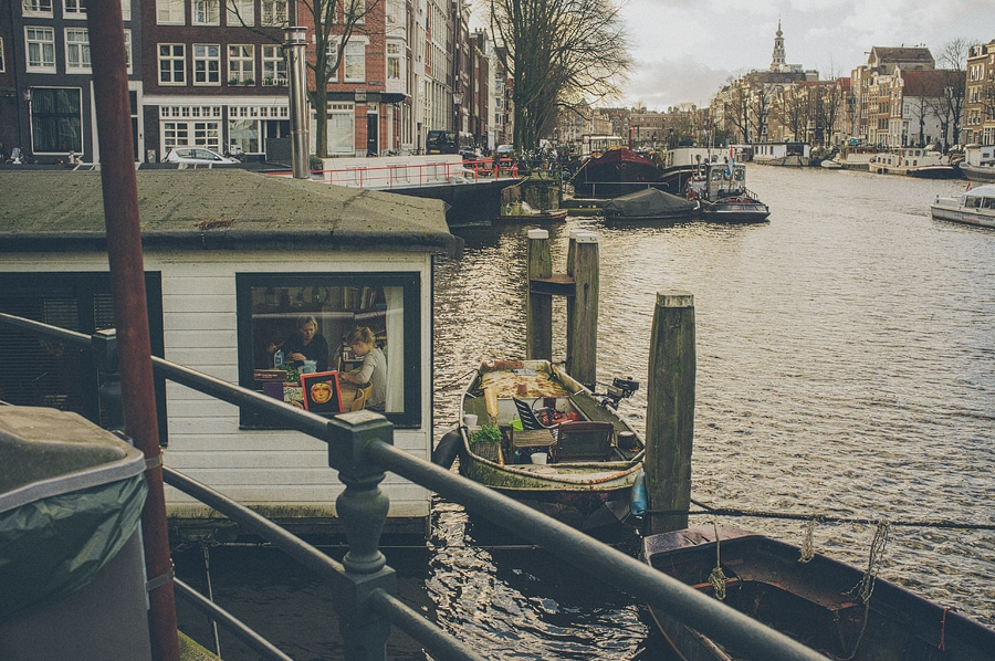 floating house on the canal in amsterdam