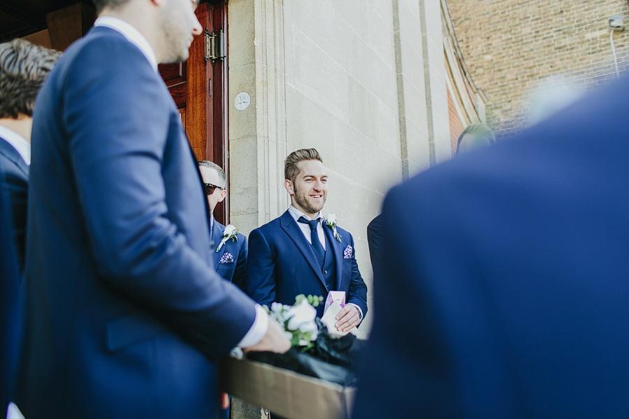 grooms ushers greeting wedding guests in bishops stortford