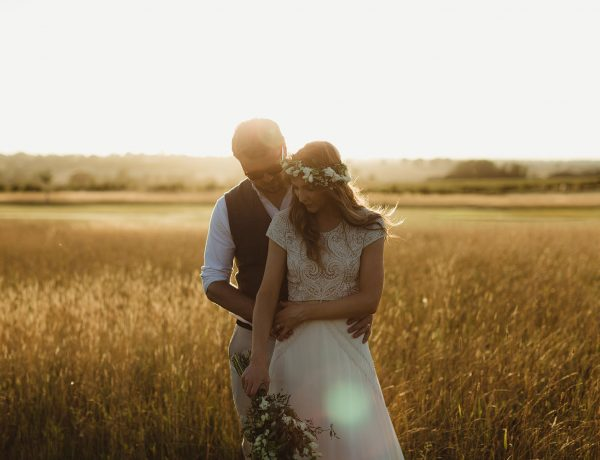 wedding portraits at sunset in field