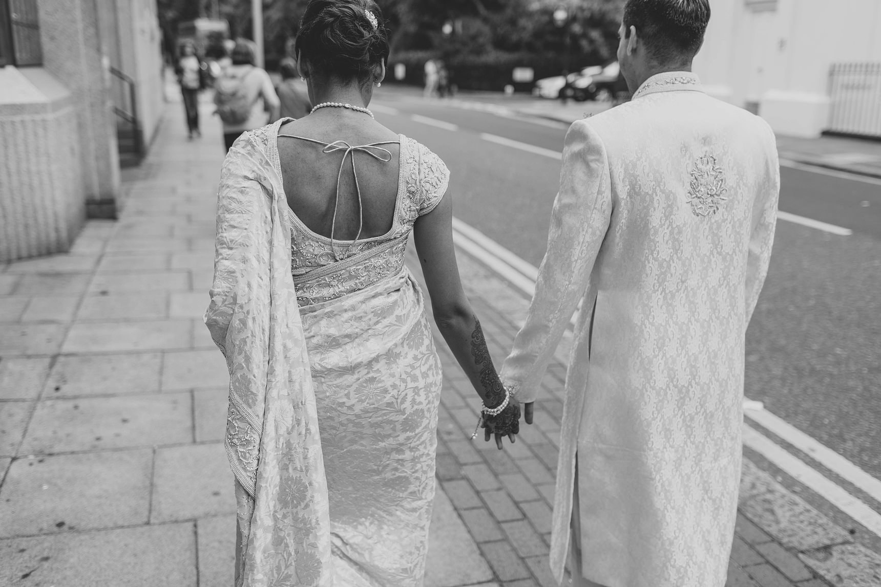 bride and groom walking the streets of london