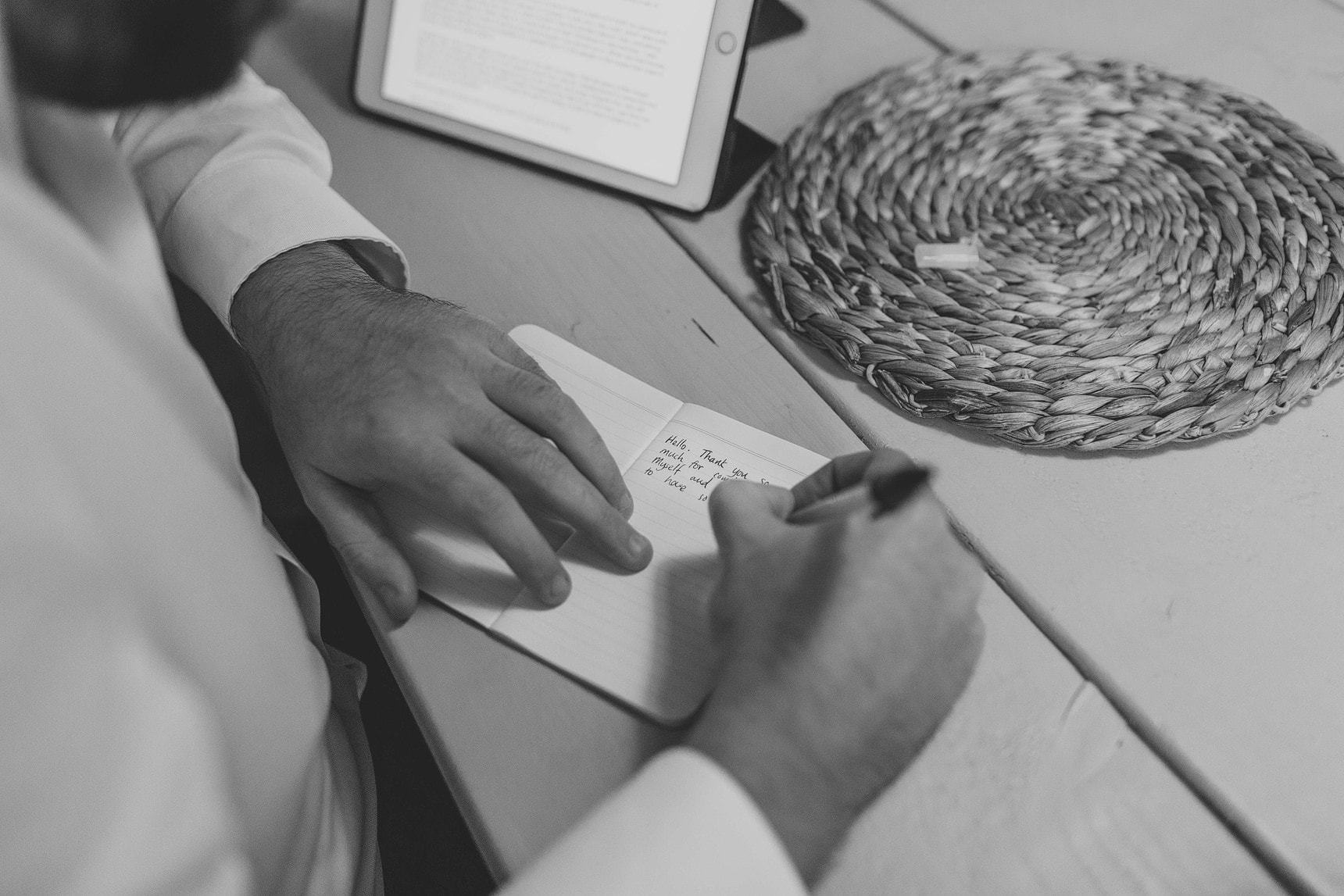 groom writing a card for his wife to be