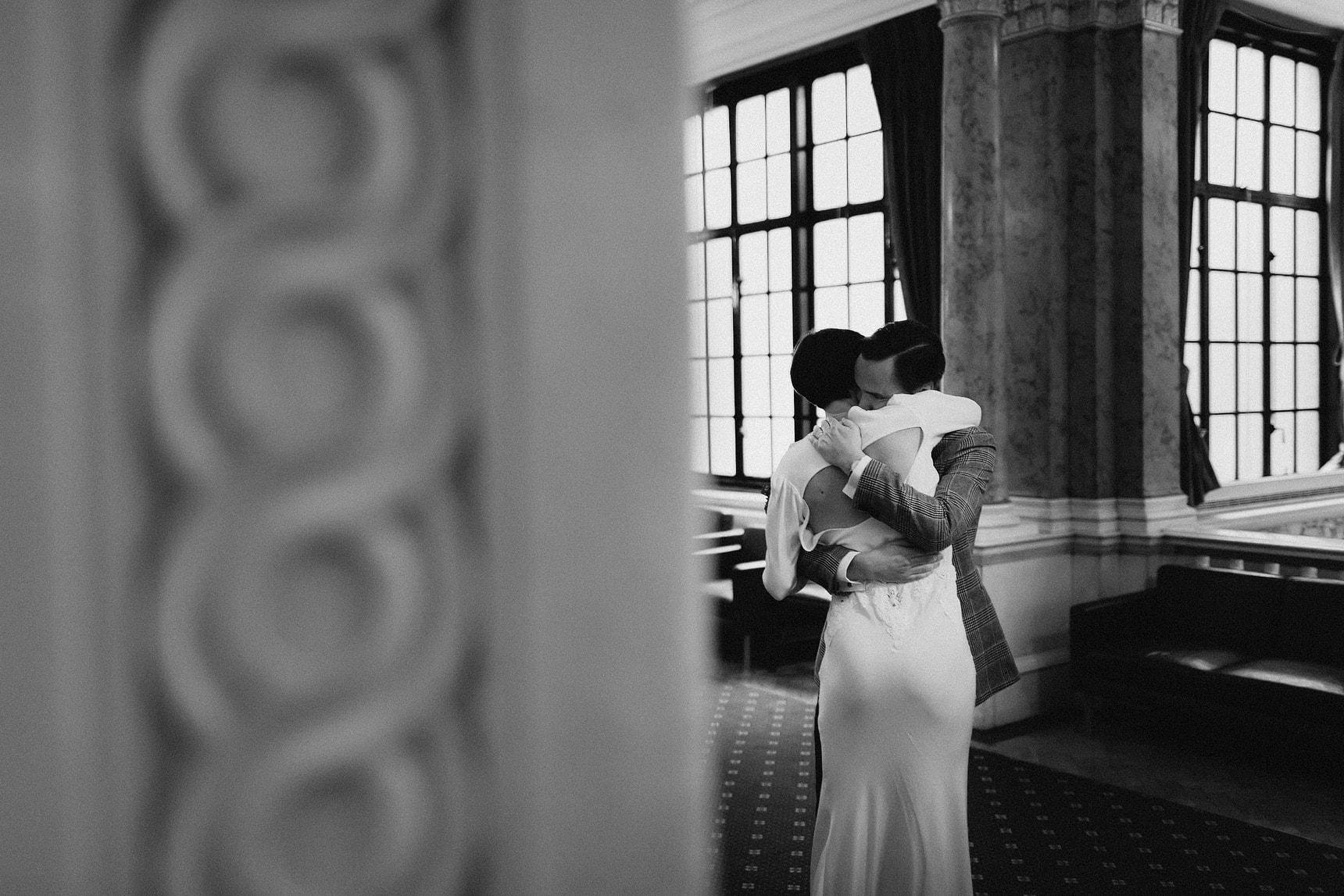 groom hugging his wife